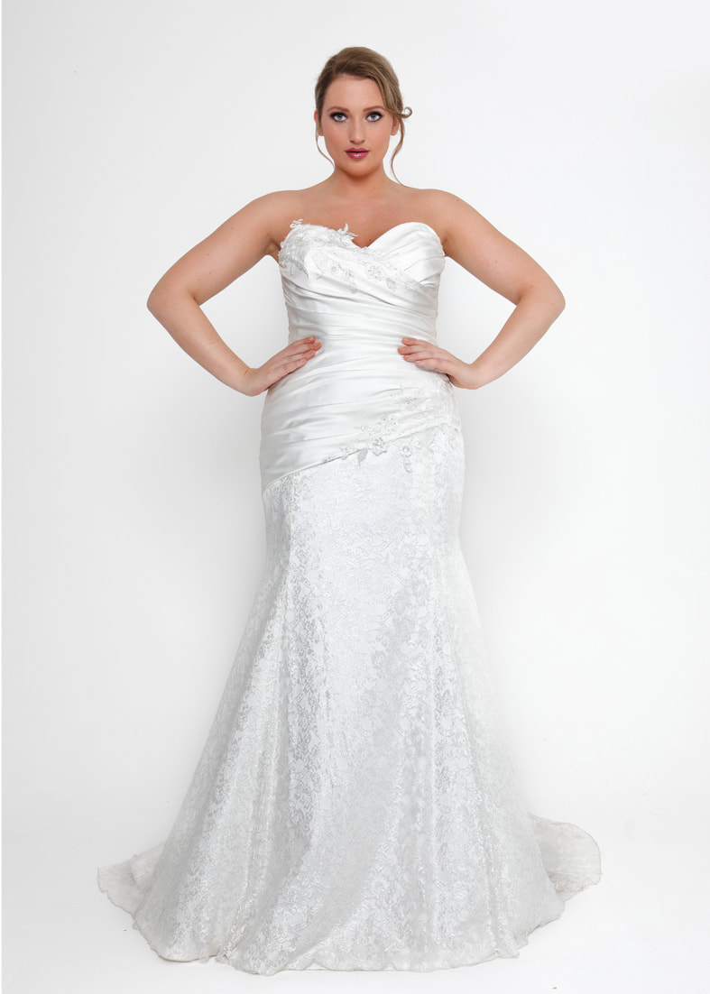 fitted strapless mermaid fit wedding dress with a pleated bodice