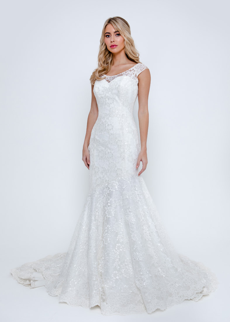Romantic fitted lace wedding dress with wide straps