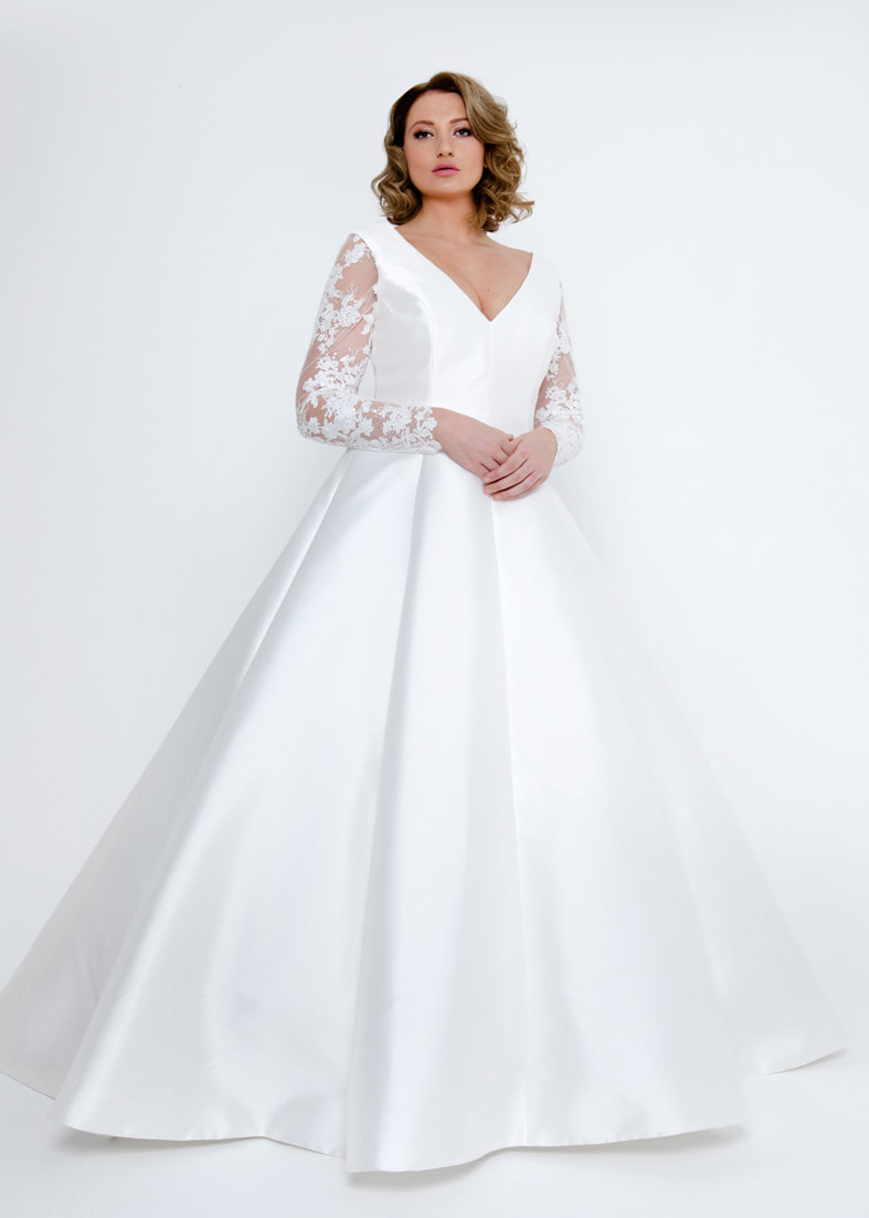 Stunning princess style wedding dress with a full ballgown skirt and sheer lace sleeves