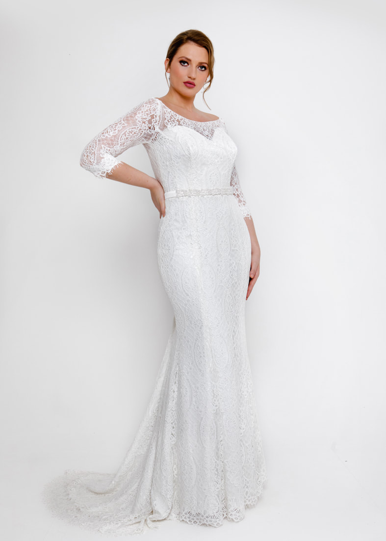 Fitted lace wedding dress with 3/4 length sleeves and puddle train