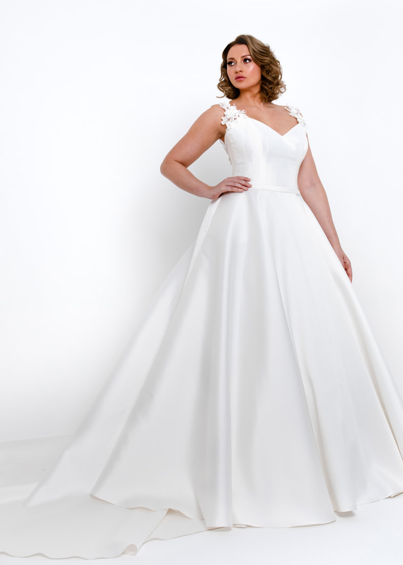 Full skirted wedding dress with sweetheart neckline and detailed straps