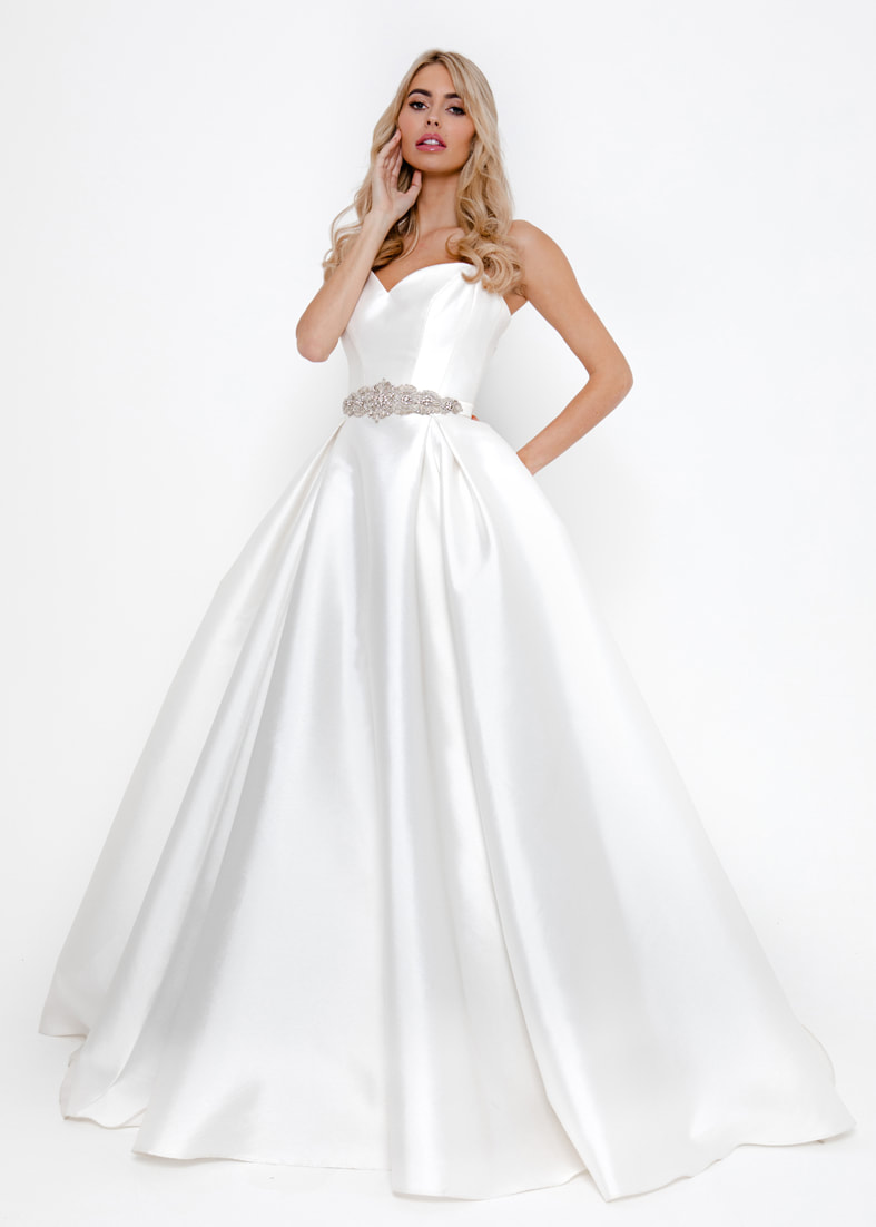 Ballgown skirt wedding dress with a sweetheart neckline and spaghetti straps
