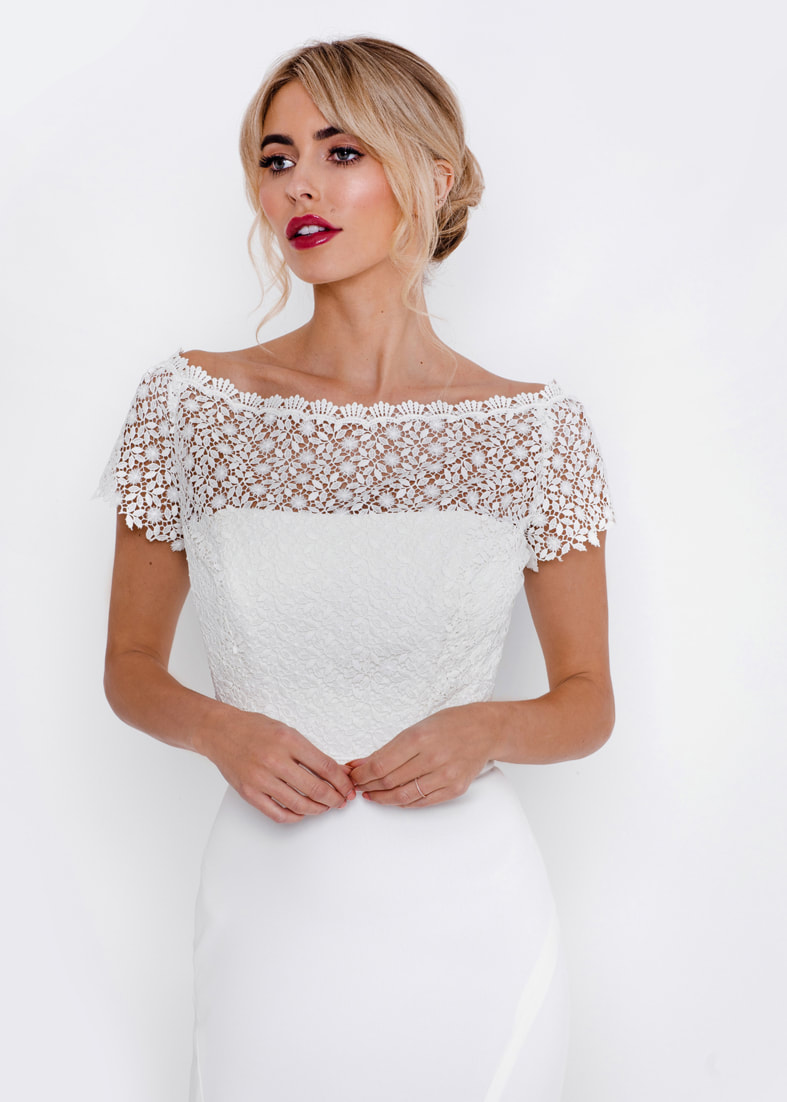 Back fastening lace bridal shrug with an off the shoulder neckline and short sleeves