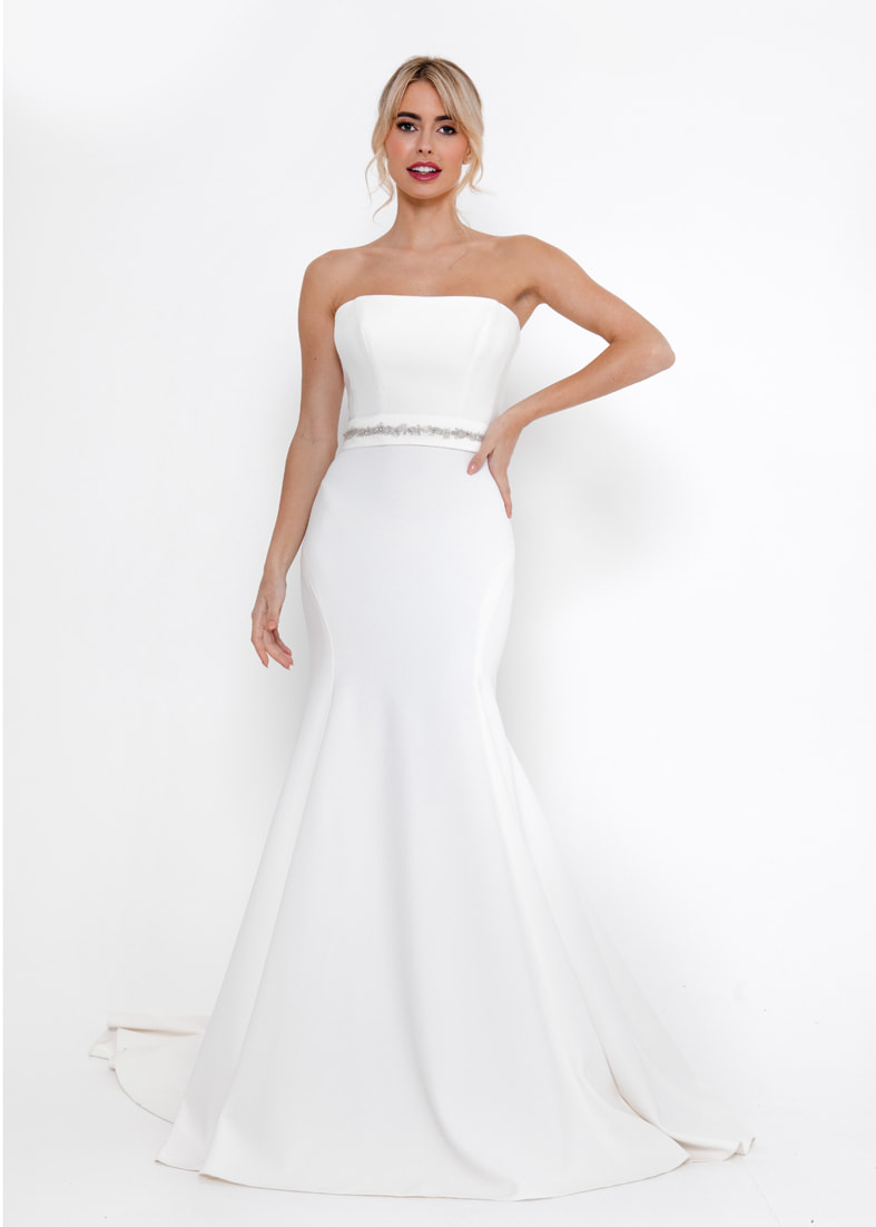 Sleek fitted strapless wedding dress worn with a narrow beaded belt